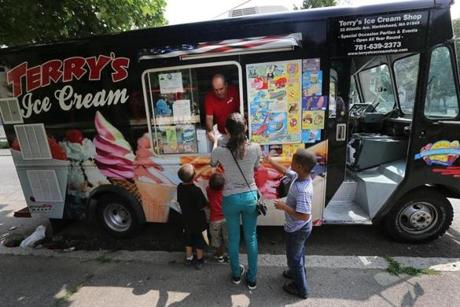 Carlos Rocha served a group of children from his ice cream truck, at Salem's Mary Jane Lee Park, before moving on.
