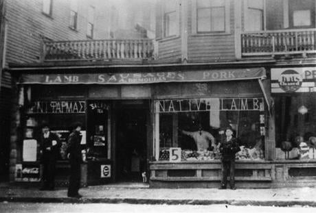 Mike Demoulas, shown in the window of his family's Lowell store, and brother George worked together to build the chain.