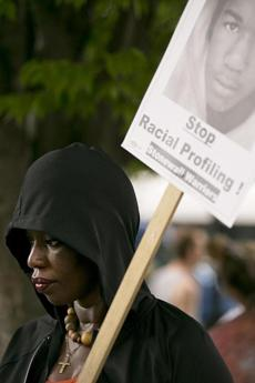 Cathy Guild, 47, of Roxbury held a sign and wore a hoodie in memory of Trayvon Martin during a protest by the Occupy movement in Dudley Square Plaza in Roxbury after George Zimmerman was acquitted in Martin's killing in Florida.  who shot and killed teenager Trayvon Martin in 2012. (Yoon S. Byun/Globe Staff) Slug: 15trayvonreax Reporter: jeremy fox LOID: 6.1.4048750613