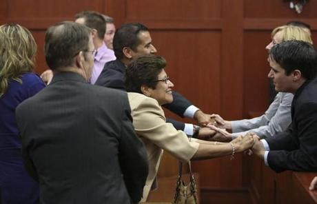 Zimmerman's family held hands with his legal team after hearing the verdict.