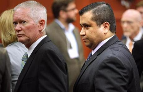 Zimmerman (right) was escorted from the courtroom a free man.
