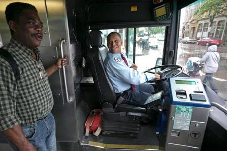 Nathan Ewusi of Dedham, who rode the T bus on Route 15 to work, has become a friend of the driver.