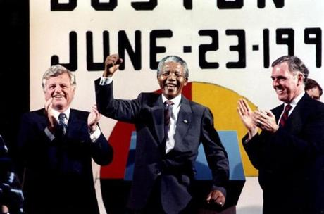 June 23 1990 / fromthearchive / Globe Staff photo by Barry Chin / Dancing to the finale music after his speech to an estimated 250,000 people at the Hatch Shell on Boston's Esplanade, Nelson Mandela is flanked by Sen. Edward Kennedy and Mayor Raymond Flynn. Musical performers included South Africa's Johnny Clegg & Savuka and Ladysmith Black Mambazo, as well as Paul Simon, Jackson Browne and Stevie Wonder. Local performers included the Boston rap group Young Nation, gospel singer Larry Watson, the Roxbury Presbyterian Choir, and soloist Linda Chorney.