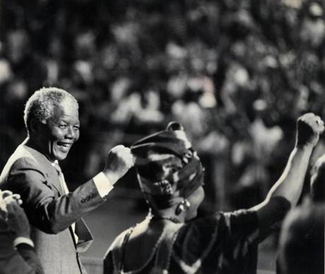 June 23 1990 / fromthearchive / Globe Staff photo by Jonathan Wiggs / Nelson Mandela acknowledged the cheers at the end of his speech at the Hatch Shell. His wife Winnie is at right. His remarks praised Boston and Massachusetts for their fight against apartheid.