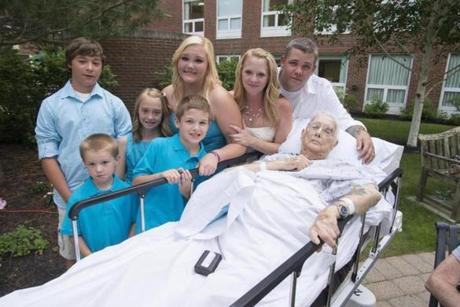 The family, from left: Joey O'Loughlin, Jarrod Hatch, Jillian O'Loughlin, Daniel Weaver Jr., Kylie Weaver, Paula Hatch-O'Loughlin, Danny Weaver and Donald Weaver gathered after Paula and Danny were married at Emerson Hospital.