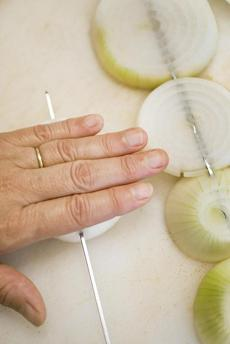 TIP Lay onion slices flat to slide skewers in.