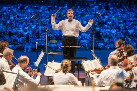 07/17/2013 BOSTON, MA Music Director Christopher Wilkins (cq) conducted during Boston Landmarks Orchestra's (cq) opening concert at the Hatch Shell (cq) in Boston. (Aram Boghosian for The Boston Globe)