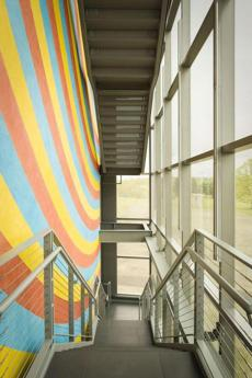 A colorful Sol LeWitt wall drawing greets visitors.