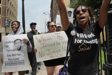 From left, Alice Hayes, Robert Traynham, Sarah Tavano, Marisa Wilson, and others marched to Park Street in Boston, where they spoke out against the acquittal of George Zimmerman in the Trayvon Martin case.