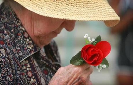 In Riverside, Calif., 89-year-old Edith Quevedo held a rose as she protested the verdict.