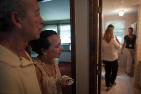 Alvaro and Martha Galvis observed a contractor and architect evaluate a bathroom in their Nashua, N.H., home. The remodeling help for bombing victims comes at no cost.