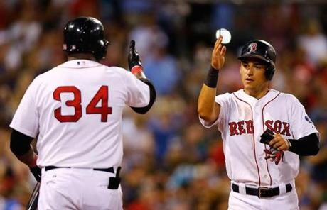 Jose Iglesias (right) was one of two runners who scored on a hit from Shane Victorino in the fourth inning, giving the Red Sox a 6-3 lead.