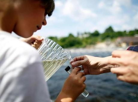 Luke Sekera-Flanders, 9, of Fryeburg, Maine, was among children who collected vials of freshwater from the banks of the Penobscot River.