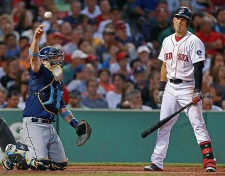 Red Sox batter Jose Iglesias reacted after a called second strike at Fenway Park as catcher Jose Lobaton tossed the ball back to pitcher Matt Moore.
