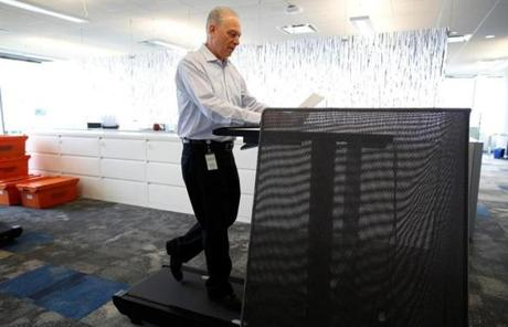 "A new Biogen complex in Cambridge  features ""walk stations"" where employees can work while walking on treadmills."