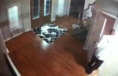 Color photos were taken from Aaron Hernandez's home surveillance system.