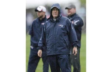Patriots coach Bill Belichick watched the team during the Patriots' first day of training camp.