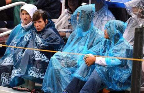 Fans sat protected from the rain in ponchos.