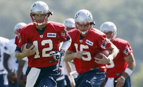 Tom Brady (from left) ran a drill followed by fellow quarterbacks Ryan Mallett and Tim Tebow.