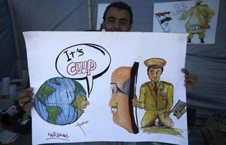A member of the Muslim Brotherhood, which backs Morsi, held a drawing in the Islamists' camp in Nasr City.