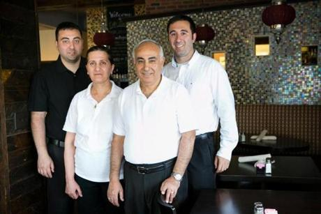 July 26, 2013 Cafe Barada in Cambridge, MA. Family owned Cafe Barada reopened after renovation. brother Charbel , mom Claude, dad Sami, and brother Joe Salameh pose for a photo lifestyle, 31cheappix, burden (Katherine Taylor for The Boston Globe)
