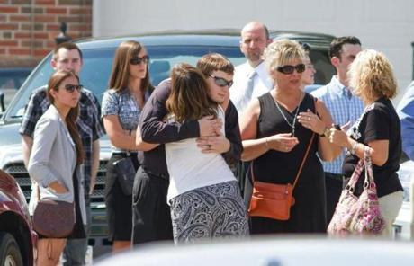 Mourners consoled each other outside a wake for Amy Lord in Springfield.