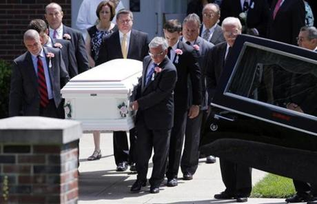 Tthe casket was carried out following a funeral Mass for the Wilbraham native.