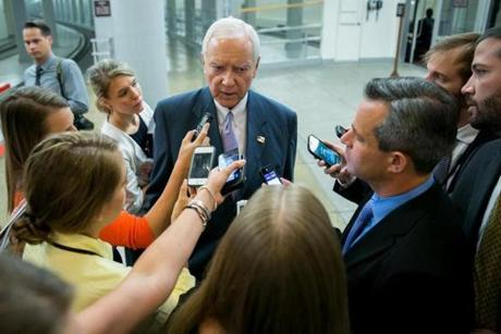 In a familiar scene for many veteran members of the US Senate, Utah Republican Orrin Hatch paused to answer questions from a cluster of reporters while walking between appointments on Capitol Hill on Tuesday.