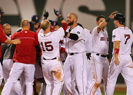 Red Sox players celebrated in the infield after the win.