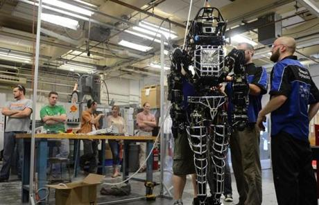 Worcester Polytechnic Institute students work on an Atlas robot, which was delivered as part of a Pentagon project.