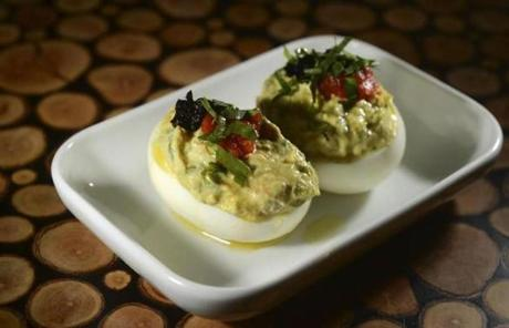Deviled eggs with tuna and black olives added to the creamy yolk.
