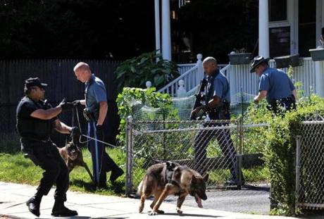 State police and canine units searched for clues and police officers interviewed residents after the shooting Wednesday.