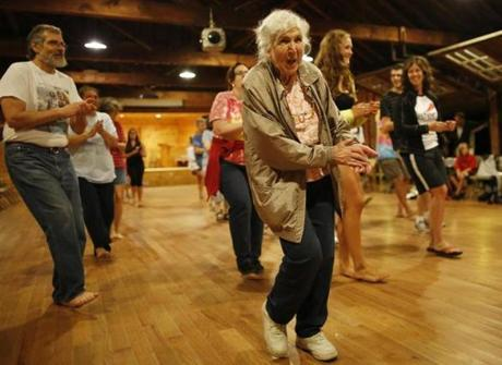 Alice Erickson, 88, partakes in line dancing at Sandy Island Family Camp on Lake Winnipesaukee in Mirror Lake, New Hampshire August 6, 2013. (Jessica Rinaldi For The Boston Globe)