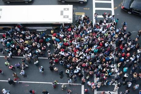 METRO - 9 AUG. Hundreds of commuters waited for a replacement bus service on Haverhill Street after an earlier truck crash on I93 North caused severe delays on the Orange T line. Friday, August 9th 2013. Colm O'Molloy for The Boston Globe.