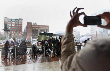 Boston, MA 080913 Passerby captured the media on an iPhone as they waited for jury deliberations in the James