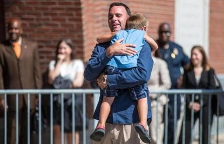 Tommy Donahue, whose father was killed by Bulger,  picked up his godson after speaking to the media.