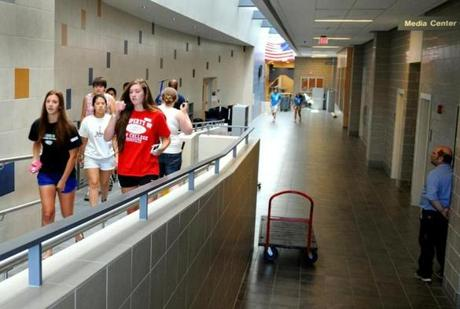 Students  walked through the hallway of the newly renovated Rockland High School. Officials hope the project is helping reverse the downward trend in enrollment.