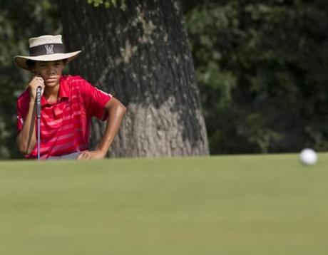 Boston, MA 8/12/2013 Andrew Walker (cq), 14, the youngest African American to compete in the US Amateur studying his lie on the 9th green during the 2013 US Amateur at the Charles River Country Club on Monday August 12, 2013. (Matthew J. Lee/Globe staff) Topic: 13US AmateurReporter: Michael Whitmer