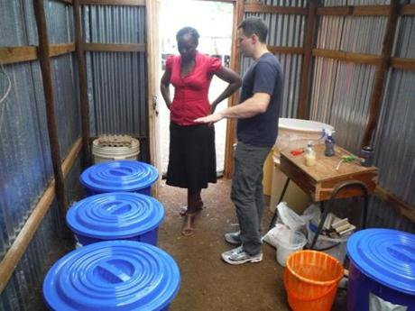 McGill team member Zev Thompson chatted with Jacqueline Oloo at a pilot cricket breeding farm in Kenya.