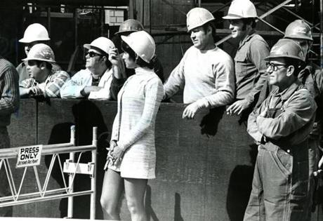 September 27, 1971:  Linda Paula, from the Public Relations department at John Hancock, mixed in with the construction workers as they watched the topping-off ceremonies for the new John Hancock Tower. Groundbreaking ceremonies were on August 21, 1968.