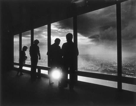 June 21, 1977: Observers are silhouetted from the 60th floor of the John Hancock observatory as they looked towards Cambridge and MIT.
