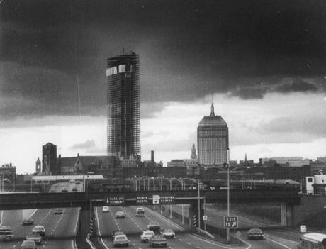 November 7, 1971:  The new John Hancock building, still under construction on the left, towers over the old one on the right in this view of the Boston skyline.