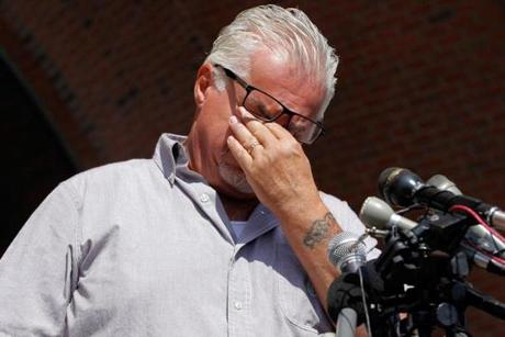 Steve Davis became emotional while speaking to reporters outside the courthouse after the jury found prosecuters had not proven Bulger guilty in the murder of his sister, Debra Davis.