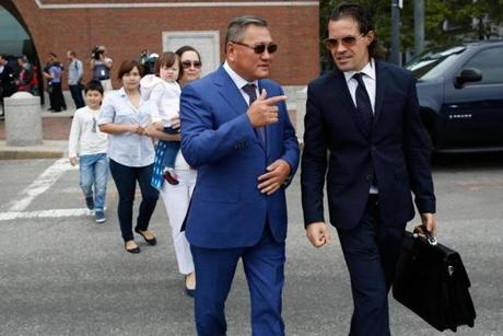 Lawyer Nicholas Wooldridge (right) walked with the family of Azamat Tazhayakov.