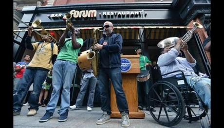 Rebirth Brass Band played in front of the reopened Forum Bar & Restaurant after a procession up Boylston Street.