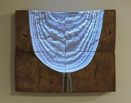 A digital projection on clay by Colby Parsons.