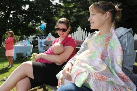 Lauren Cairns (left) and Melissa Church breast-feed their children at a support group meeting in North Conway, N.H.