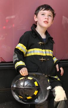 Mikey Robinson, 7, of South Boston, watched the fire for about 45 minutes with his father Michael Robinson.