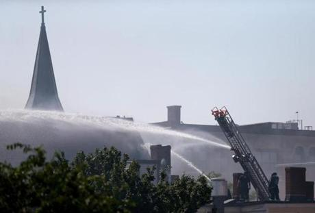 Firefighters battled a five-alarm blaze that tore through a historic church on Broadway in South Boston.