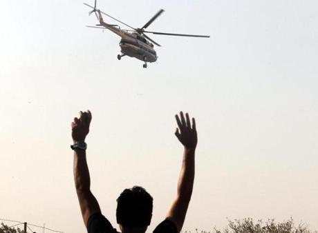 An Egyptian supporter of former president Hosni Mubarak waved to a helicopter carrying him from the Torah prison in Cairo to the Maadi military hospital.
